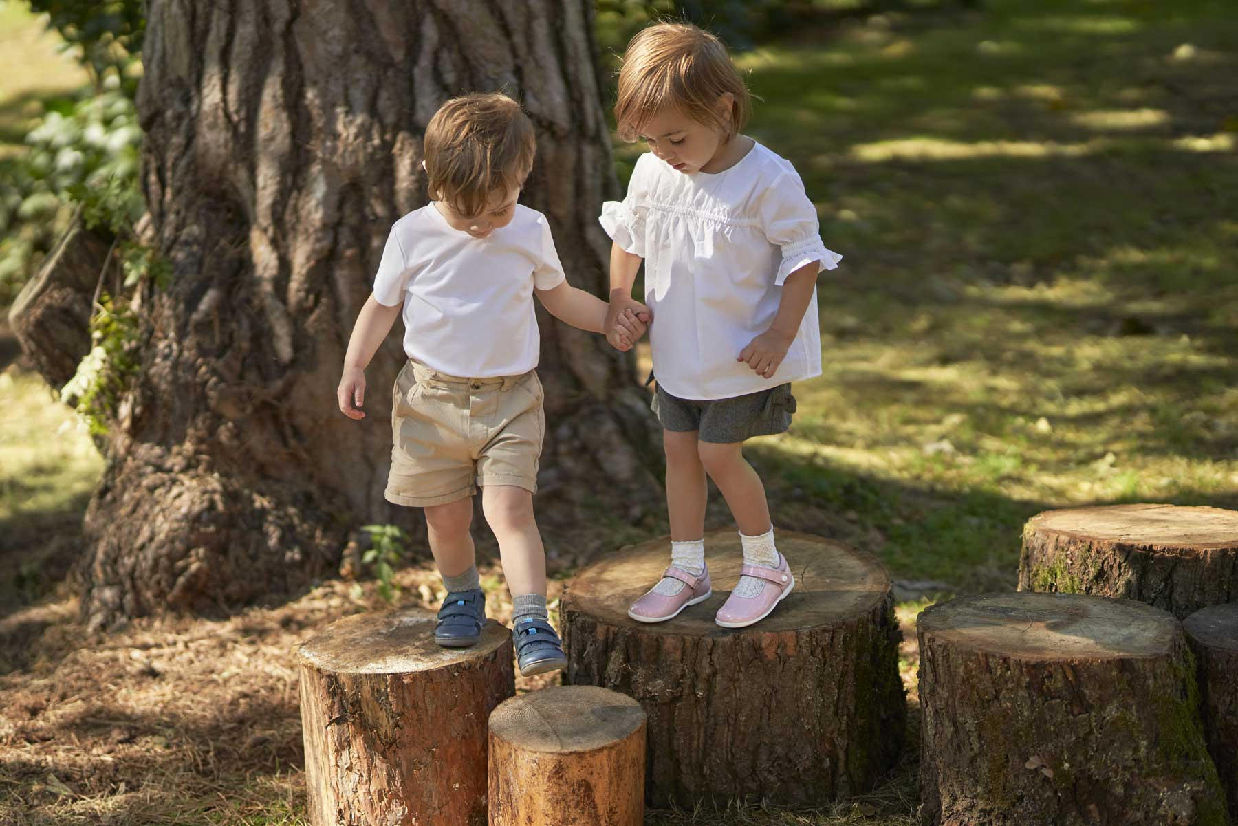 Girl and Boy on Logs